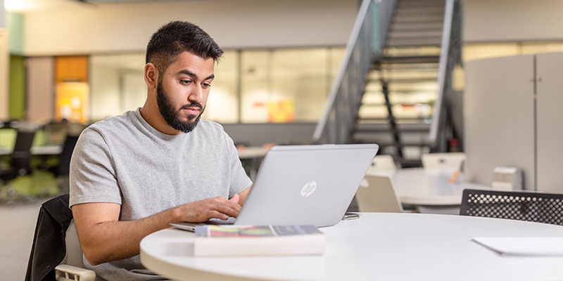 Image representing a student studying for assessments at the University of Leeds.