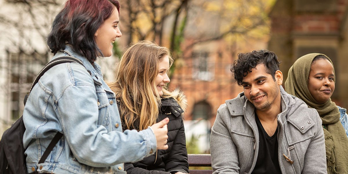 Group of University of Leeds Psychology students sat on a bench