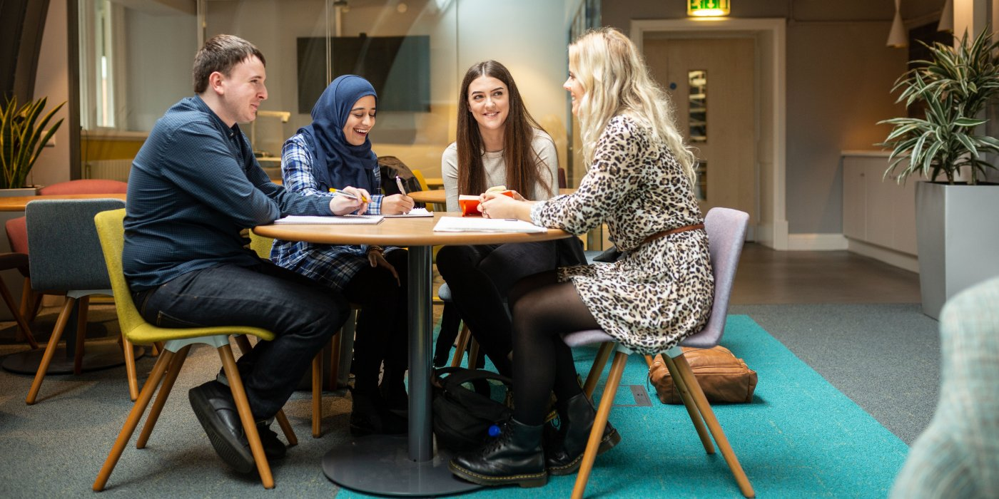 Social Work and Mental Health students sat around the table talking at the University of Leeds