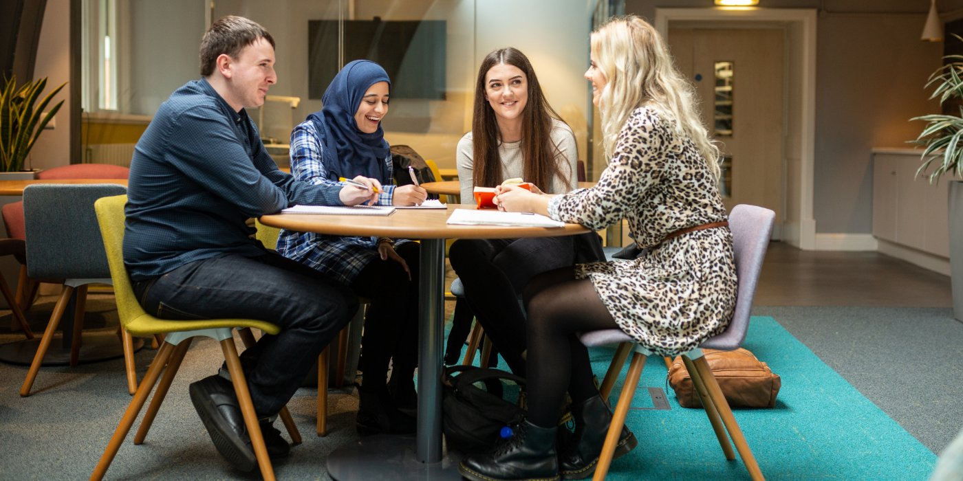 Group of mental health and social work work students sat studying in the Baines Wing at the University of Leeds.