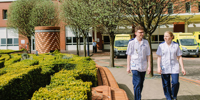 Two healthcare students walking outside Leeds General Infirmary.