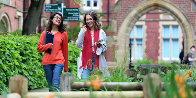 Two University of Leeds School of Healthcare students walking on campus