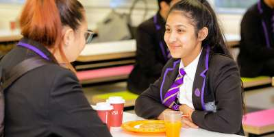 Students from Leeds City Academy enjoying their free breakfast.