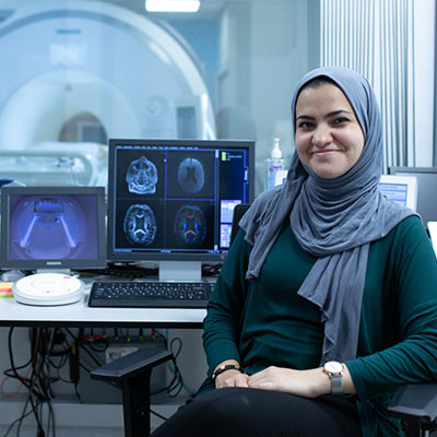 International licamm phd student next to MRI scanner